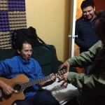 Ruymundo on the guitar with friends